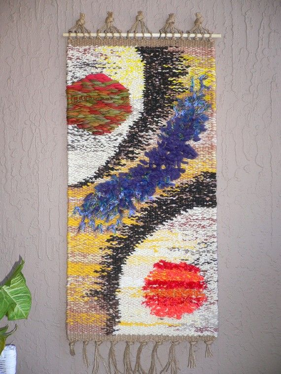 Double Universe...hand woven tapestry. $135,00, via Etsy.