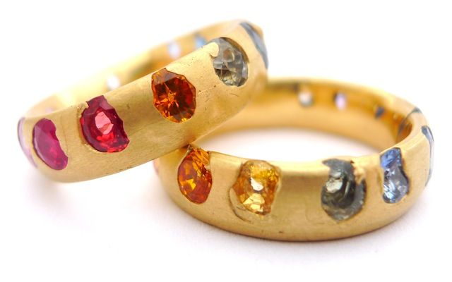 Polly Wales Crystal Collection Bands: Polly uses gemstones directly cast into gold, creating pieces that resemble natural gem encrusted forms, like sparkling geodes split open, or discoveries from the deep. This unorthodox process is unique to Polly and has become her signature style, gaining her international recognition at major exhibitions and in craft and jewellery galleries.