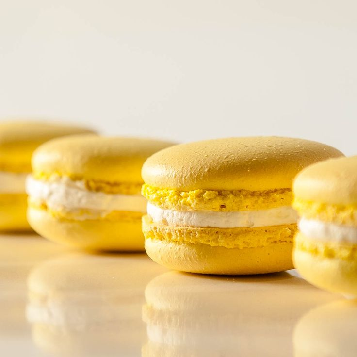 Lemon Macaron with its crispy almond meringue shell, succulent buttercream and tart lemon curd filling brings out the cooling sensuality of the lemon flavor—always a refreshing, always a winner. http://www.thefinercookie.com/new-blog-1/2015/1/26/lemon-macarons