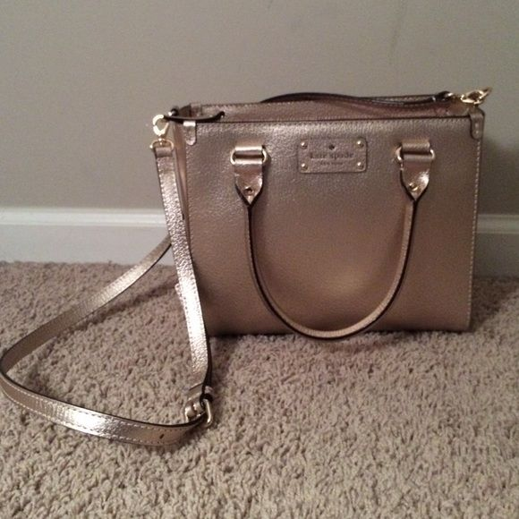 BRAND NEW ROSE GOLD KATE SPADE PURSE!! BRAND NEW still has tags!!! it looks gold in the picture but it is rose gold. SUPER cute & SUPER fashionable I love it ❤️ kate spade Bags Totes