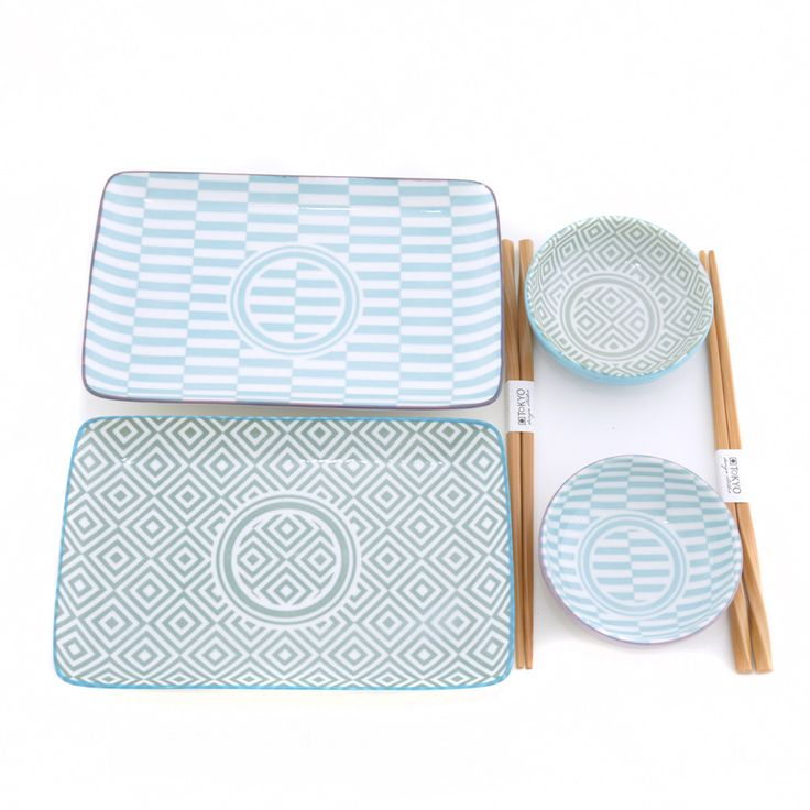 Tokyo Design Studio Geo Porcelain Plate Set : Four piece boxed porcelain plate set by Tokyo Design Studio. The set comprises two rectangular plates in blue and petrol geo eclectic patterns with matching round small dishes, and two pairs of chopsticks.
