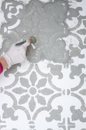 A step by step tutorial sharing how we stenciled our patio giving it a makeover on a budget.