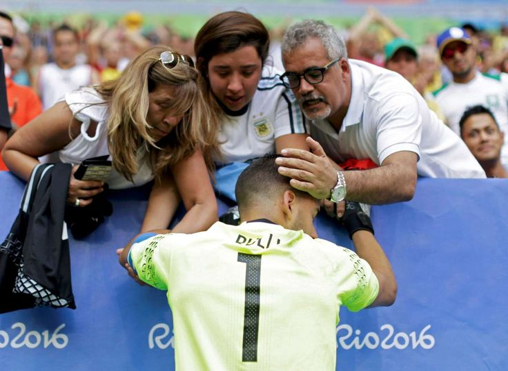 Heartbreak for Argentina: Argentine goalie Gerónimo Rulli is consoled as his team crashes out of the Olympics after a 1-1 draw with Honduras during the Men's Group D first round soccer match. - 2016 Rio Olympics: Highs and lows from day five