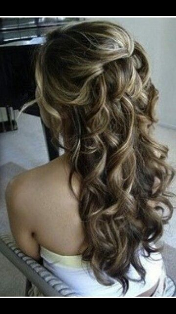 Prom hair adding a jewel on the top of the half up half down