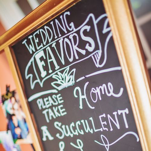 A handwritten sign added a personal touch, inviting guests to take home their succulent plant favors from the reception. Photo Credit: Civic Photos