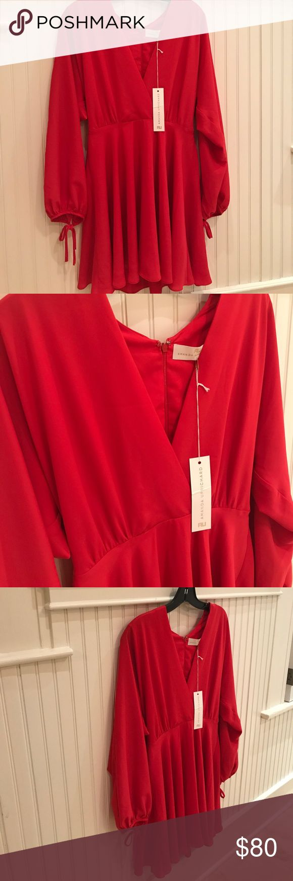 NWT Amanda Uprichard Dress NWT Silk Amanda Uprichard Dress in beautiful vibrant bright red - perfect for the holidays! Deep V top with a slightly flared skirt. Sleeves tie at the wrists making this a fun twist.  Size Small. Amanda Uprichard Dresses