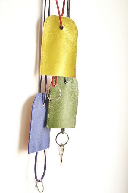 Leather key chain holder tutorial,  I would try it with fabric, a small grommet and a satin cord.