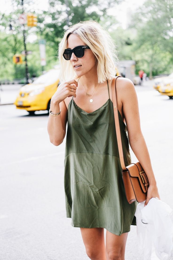 olive green dress, camel purse. Image Via: Damsel In Dior