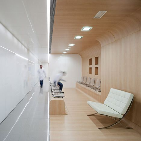 Spanish architects Estudio Hago have completed a dental surgery with walls of rounded wooden panels and white-tinted glass. The surgery occupies a floor within an office block in Málaga. Treatment rooms are lined up along the north side of the building so that they can benefit from even levels of natural light. Offices and consultation rooms …