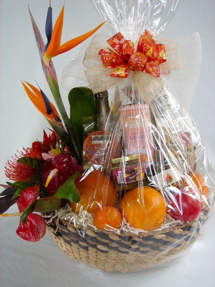 """""""Tropical Splendor"""" A unique Hawaiian gift basket with gorgeous fresh tropical arrangement, fresh fruit and made in Hawaii snacks and tropical tea.  Made by: Exquisite Basket Expressions. Price:$180.00"""