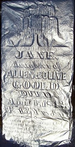 Using aluminum foil to read difficult-to-read inscriptions on grave markers.