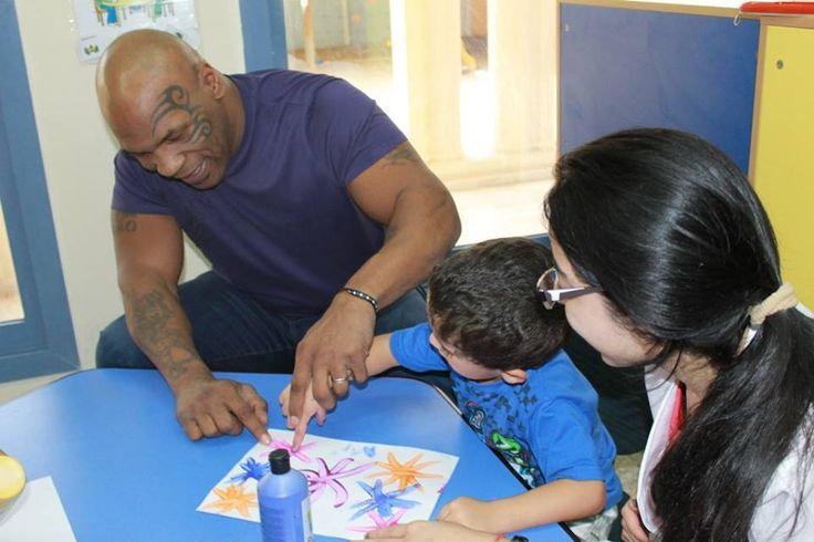 Mike Tyson & the kids at Dubai Autism Center  Mike Tyson has shown his softer side today by spending the afternoon at DAC and helping children with autism to paint and play with toys. He was also given a tour to various facilities at the Centre where he had the opportunity to spend time with the students