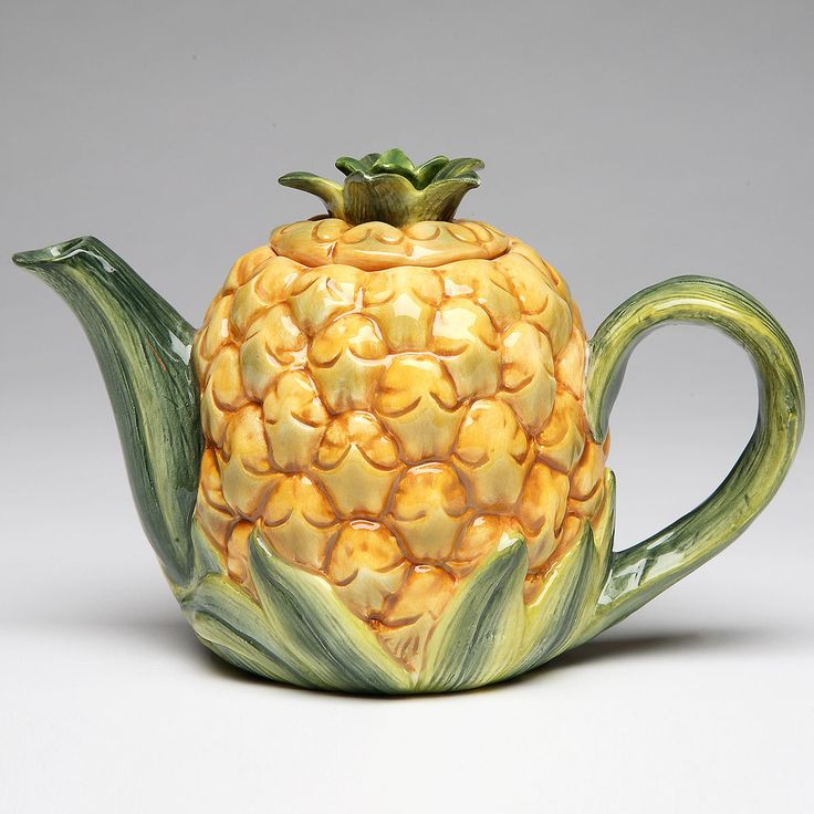 This tropical pineapple teapot looks good on a kitchen counter, dining room tabletop, or displayed in a decorative collection. Made of ornately sculpted ceramic with finely painted details. Measures 6W x 4H x 4D inches.