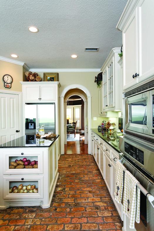Rustic brick floor. Love this kitchen.