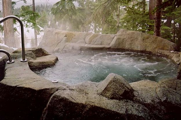 Hot springs hot tub This tub, surrounded by rock and stone ...