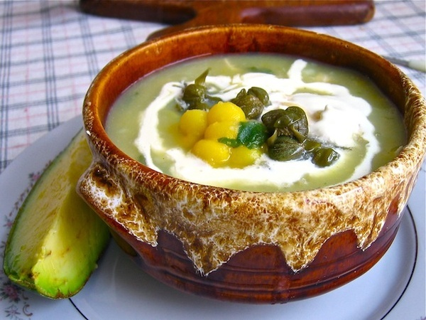 Ajiaco - Colombian food cooking. A common soup made with chicken and potatoes!