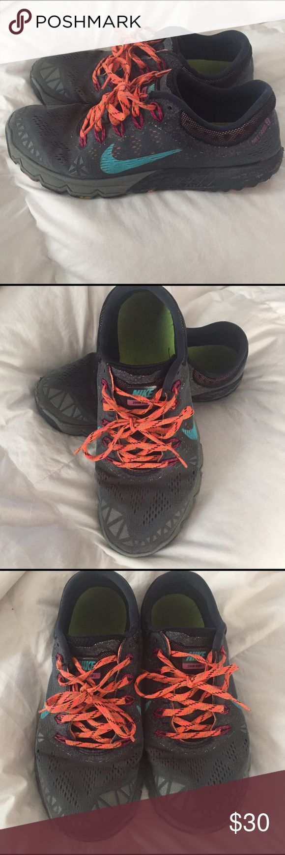 Nike workout shoes Nike workout shoes great for hiking and running. They are a grayish deep blue with a teal swoosh and orange shoe strings. They are in great condition though the tread on the bottom is a little worn down. Nike Shoes Athletic Shoes