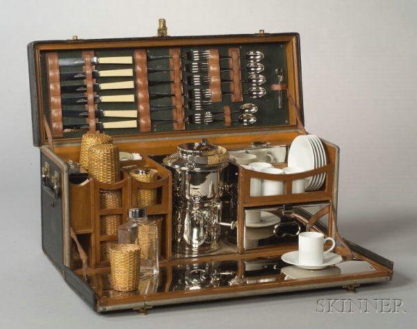 """Drew & Sons Edwardian """"en Route"""" Picnic Set. in leathered wooden travel case with side lifting handles, fitted to interior with cutlery, silver plate sandwich boxes, kettle on burner, rattan-wrapped beakers and flasks, and salt and pepper shakers"""
