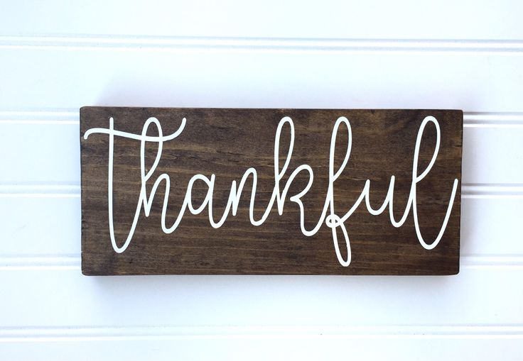 This hand painted  Thankful rustic wood sign is the perfect addition to your home decor! This sign has been stained with Dark Walnut and painted with white lettering. This sign is roughly 10 x 4.50. Each piece is sealed with a light coat of polyurethane to ensure these signs will be part of your home for years to come.    PLEASE NOTE: >>These signs are handcrafted from reclaimed wood. Each piece of wood may have natural imperfections such as knots, nicks, and structural cracks. Therefor...