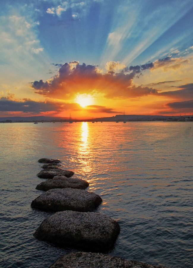 i would love to sit out on one of those stepping stones and savor the sunset view.. gorgeous! <3
