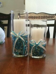 Boy Baptism centerpiece. Very inexpensive. Got everything except the ribbon at the dollar tree. The white ribbon has lil crosses, you can find it at Joan's craft store.