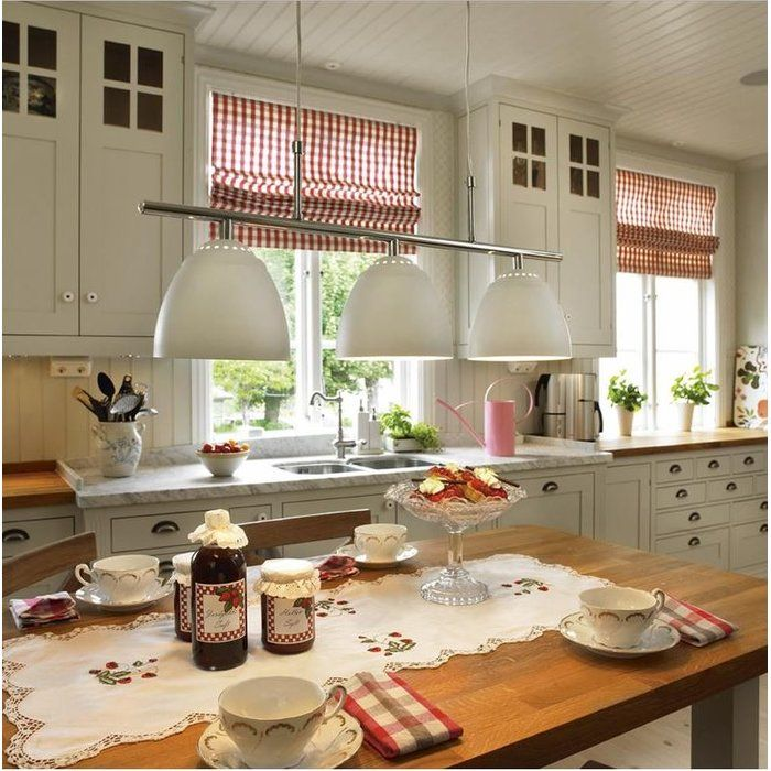 Crafted from metal, this 3-light pendant is wonderful for adding a touch of statement style to your kitchen or dining room.