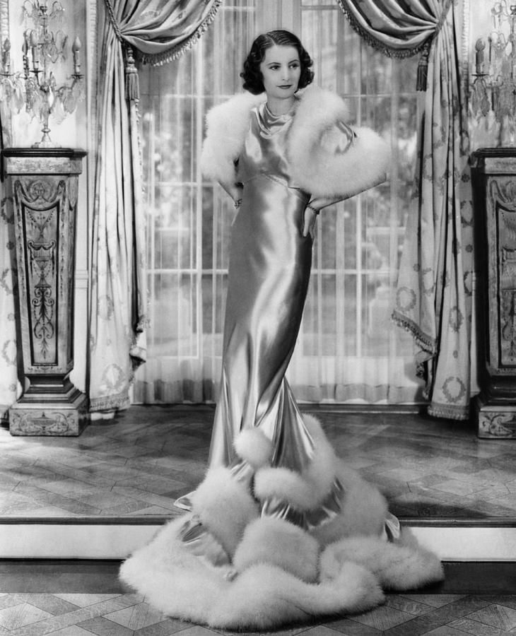 Gambling Lady, Barbara Stanwyck, 1934.. the age of glamour.. Love this dress with ermine trim.. so elegant.. why don't women dress this way now instead of such bare breasted cut down to your 'business'  stuff..  this is sooooooooooo much more elegant and classy.