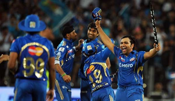 Mumbai Indians' cricketers celebrate their victory over Pune Warriors India at the end of the IPL Twenty20 cricket match between Pune Warriors India and Mumbai Indians at The Subroto Roy Sahara Stadium in Pune on May 3, 2012.