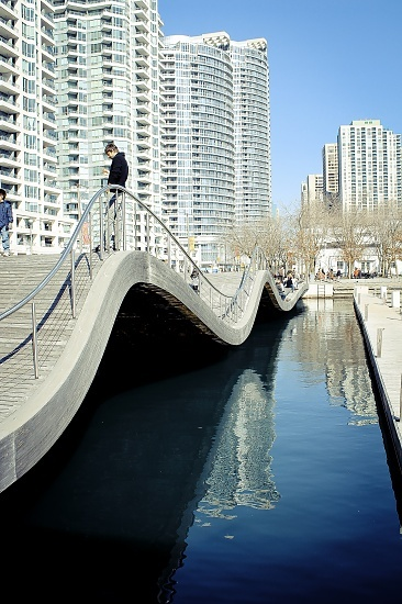 Toronto, Ontario, Canada. Bridge, curve, water, reflection, blue sky, swirl, architechture, city view, photo.