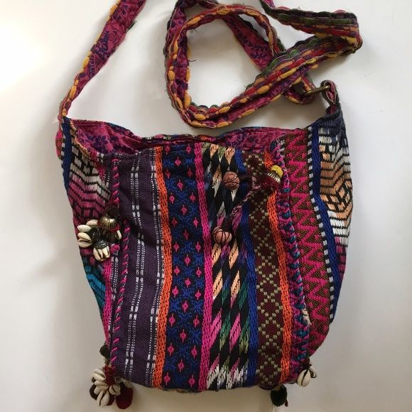 Urban Outfitters bohemian purse Colorful Urban Outfitters bag with embroidered adjustable strap. Fully lined with pink batik fabric. Urban Outfitters Bags Crossbody Bags