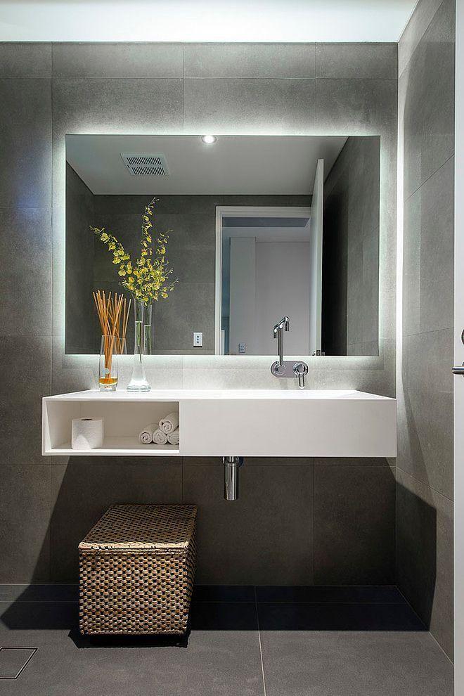Lavado com bancada em Quartzo branco, parede em cimento queimado e espelho com iluminação LED