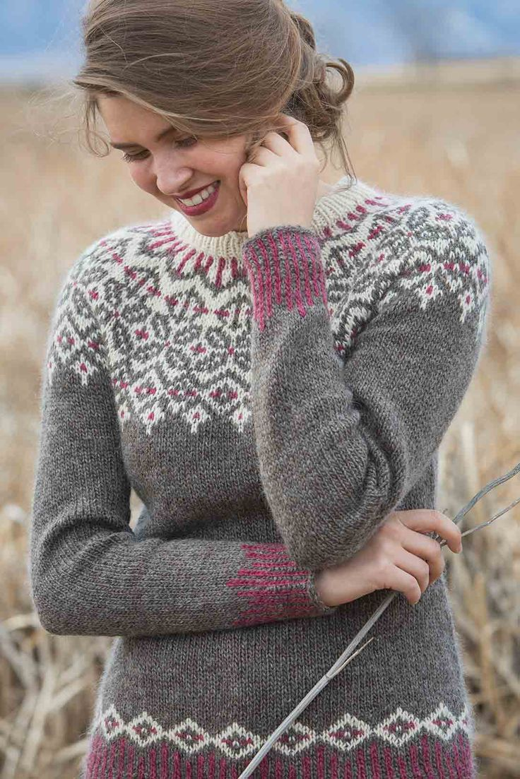 The Grand Forks Pullover showcases a traditional circular yoke with neutral tones and a pop of rich color. The corrugated ribbing at the hem and cuffs creates visual interest in this gorgeous design from Cheryl Chow, and the waist shaping provides a flattering fit.
