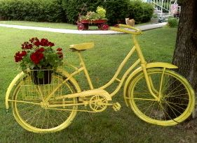 Spray paint an old bike for a delightfully original planter.