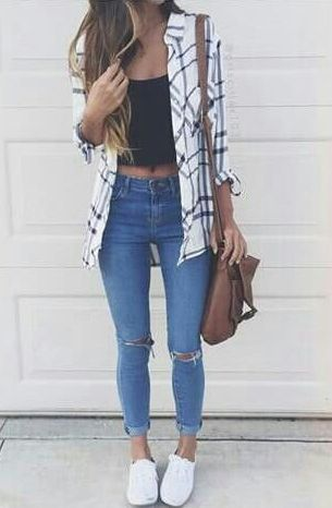 Light Jeans, black crop top or cami, white trainers, wavy hair. White striped shirt.