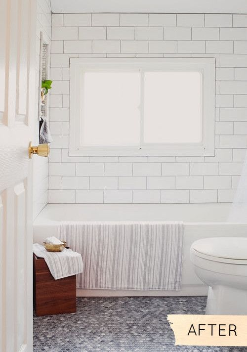 love the classic white subway tile with the grey grout and the grey penny tile on the floor