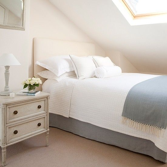 The spare bedroom is up in the eaves, but pale colours keep it looking airy. Having the guest room upstairs means that the owners and their guests have their own space and a feeling of privacy, plus it has its own en suite - an added bonus that will ease demand on the main bathroom. Blue-grey fabrics add interest, while being subtle enough to appeal to any taste.  Similar bed, The White Company, Similar chest of drawers, Rose & Grey.
