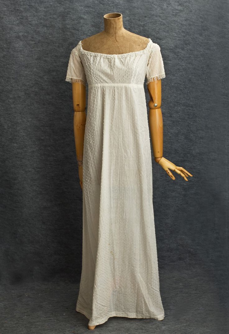 French beaded cotton evening dress, c.1805. Here is the quintessential and revolutionary Neoclassical style: the Empire waist; wide, open neckline; and a small back train. The peerless Directoire dress is covered with opaque white Bohemian glass bugle beads. Speaking to us across two centuries, the endearing charm is just as fresh and irresistible as when worn to a first grand ball. http://www.vintagetextile.com/new_page_580.htm