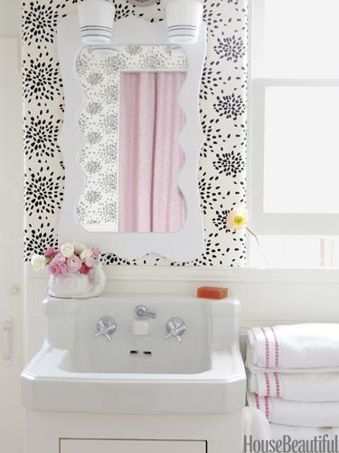 A tiny beach house bathroom with Hinson's Fireworks wallpaper by Albert Hadley. Design Krista Ewart