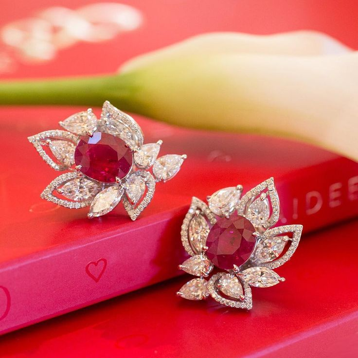 A perfect match - earrings with two oval Burmese Rubies of the iconic Pigeon's Blood colour complemented with top quality marquise and pear-shaped diamonds. They are currently displayed at the Burmese Ruby exhibition - Belle Époque salon, the Hermitage Hotel, Monaco.