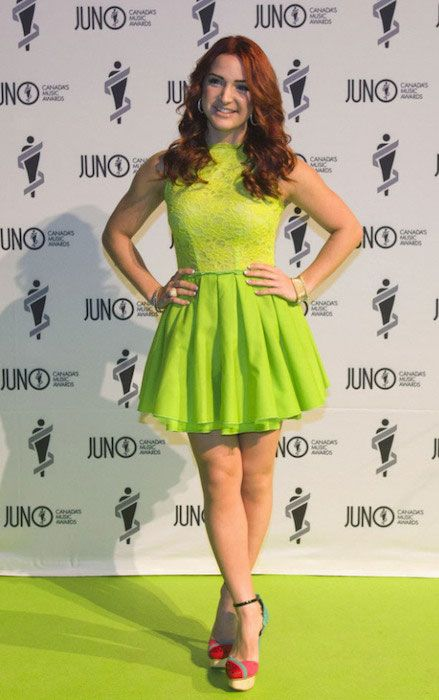 Victoria Duffield poses for a photo on the green carpet at the 2013 Juno Gala....