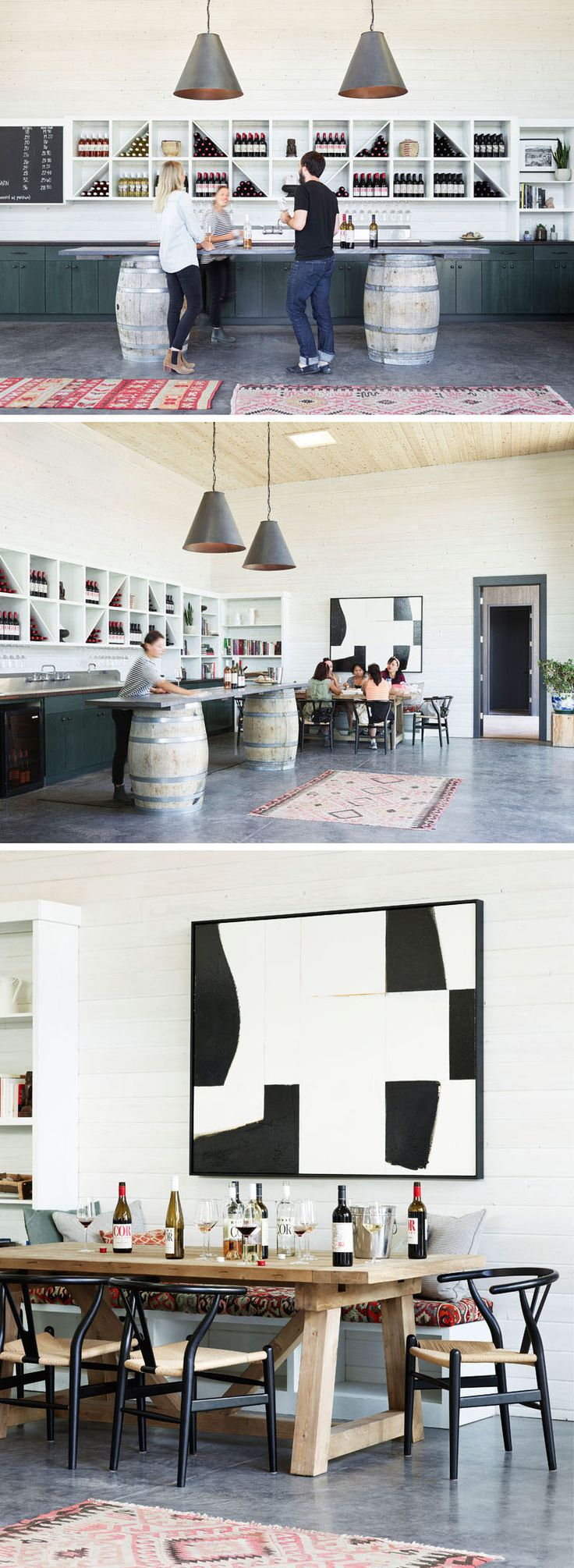 Inside this modern winery tasting room, whitewashed hemlock planks cover the walls, and a tasting bar sits on top of two wine barrels. Open shelving displays all of the current wines. At the end of the bar is a larger table with bench seating for small groups.