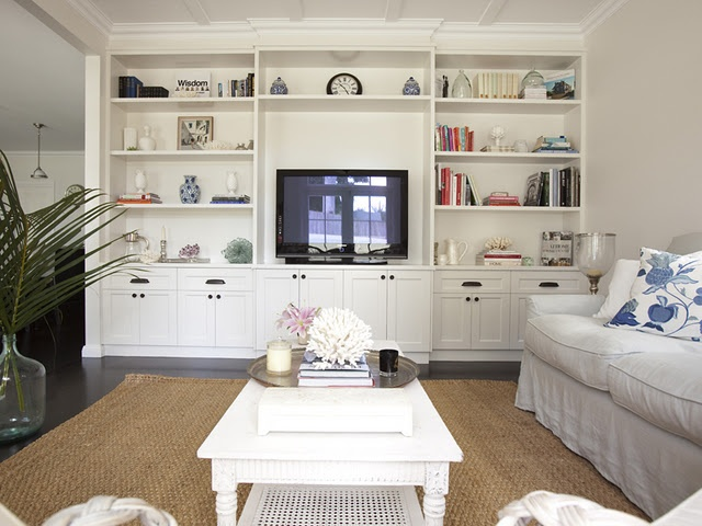 One wall of living space for tv but also a full wall of storage - perfect