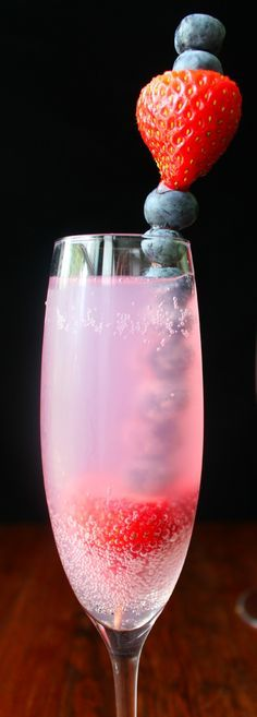 The perfect Fourth of July drink recipe! A nonalcoholic sparkling beverage with a fruity swizzle