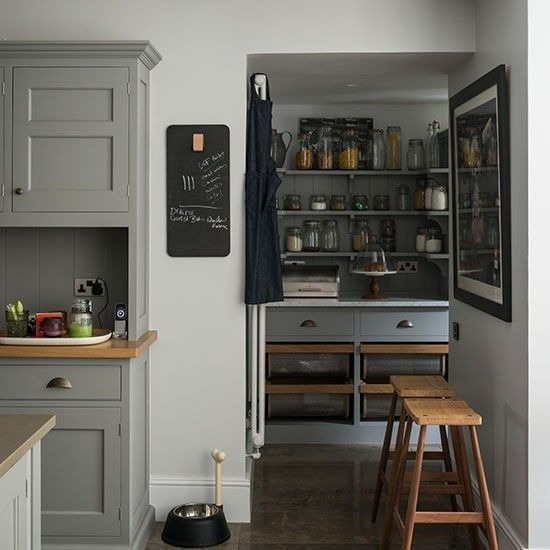 Gray English Kitchen Larder/Remodelista. Beautiful cabinet colour with the timber tops and white walls.