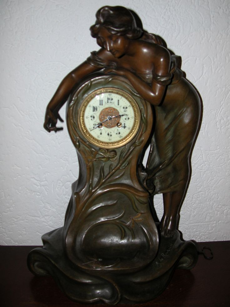 Art Nouveau French spelter pendule by A. de Ranieri.   Woman try to catch a dragonfly. Height 58 cm.