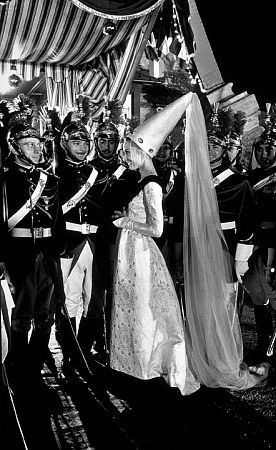 """""""Paris When It Sizzles"""" Audrey Hepburn flirts with the Presidential Guards at the Eiffel Tower location"""