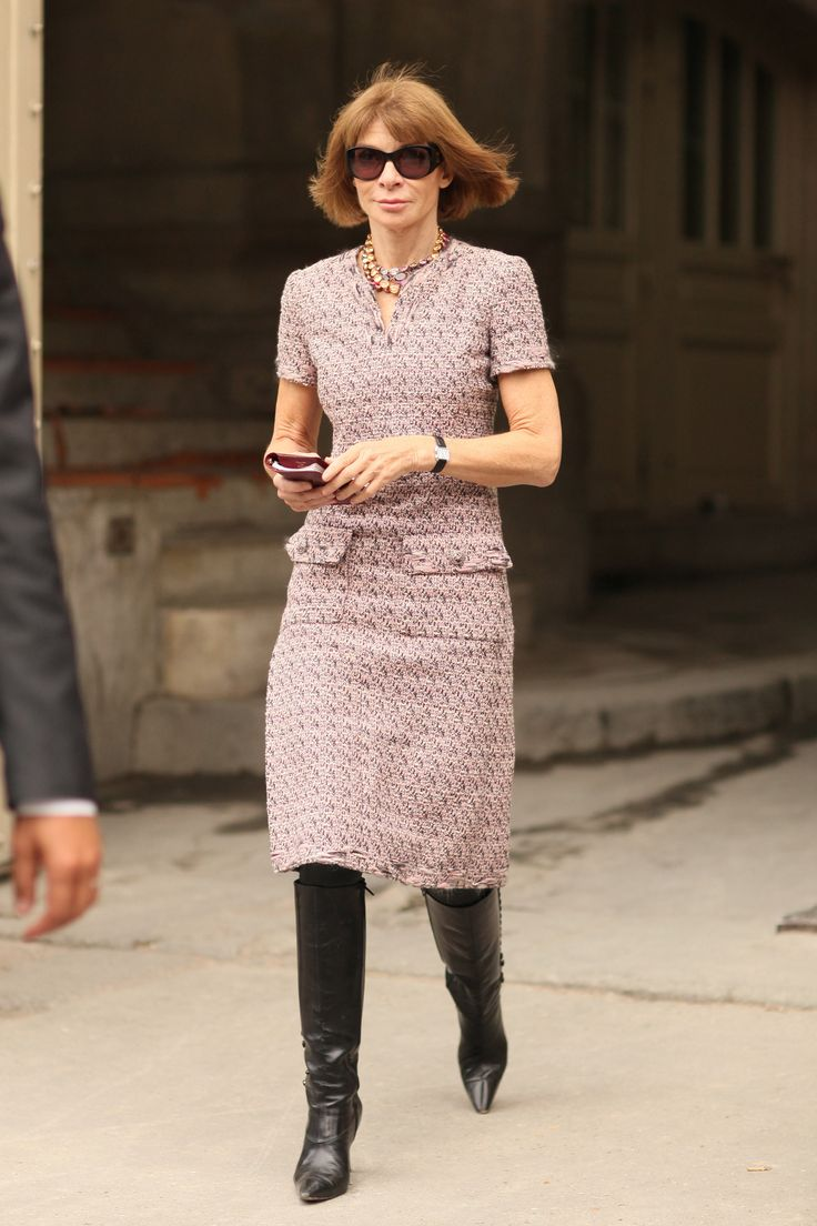 Anna Wintour channeled her editor-in-chief signature in a tweed sheath and knee-high boots.