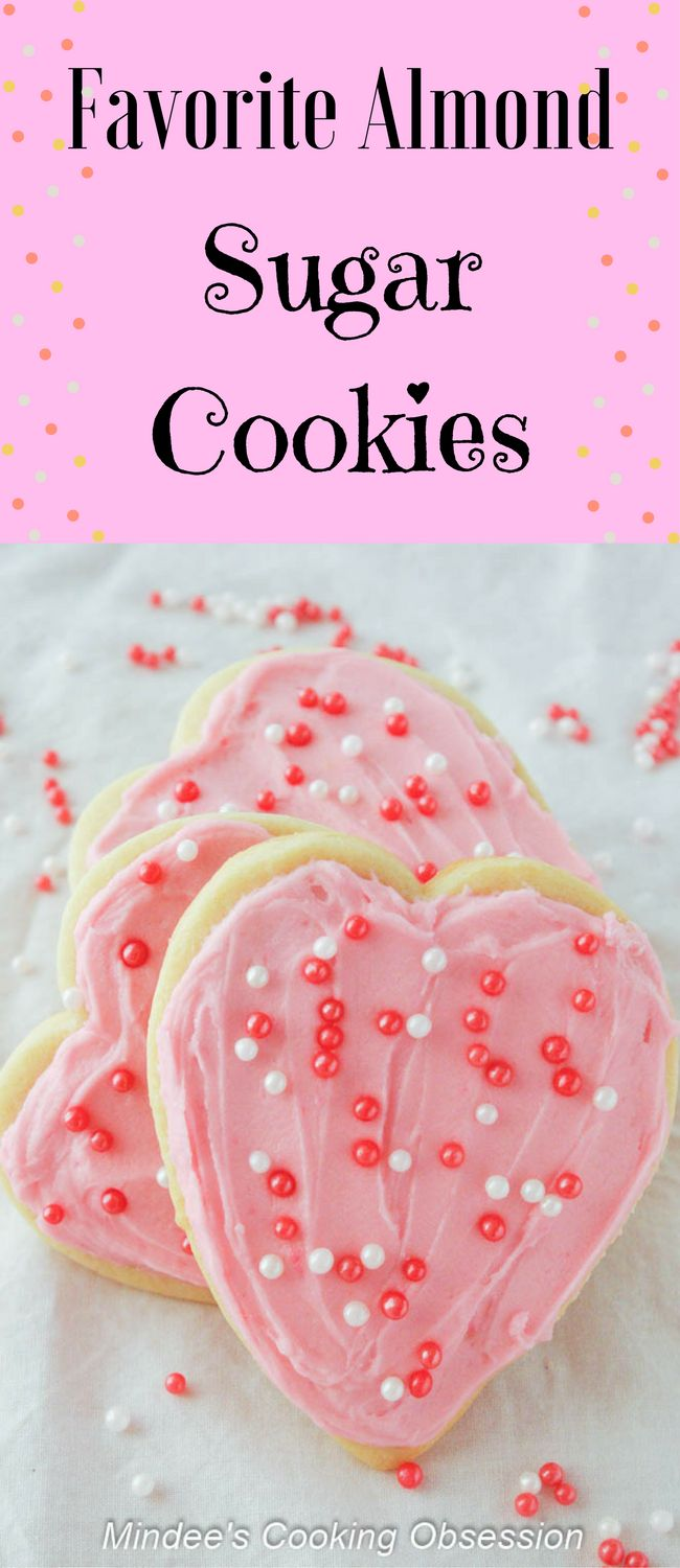 Favorite Almond Sugar Cookies- Favorite almond sugar cookies are truly my favorite!  These easy roll out sugar cookies are delicious frosting or topped with sprinkles! via @https://www.pinterest.com/mindeescooking/ #sugarcookies #valentinesday #heartcookies
