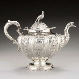 AN ELABORATE VICTORIAN SCOTTISH SILVER TEAPOT,