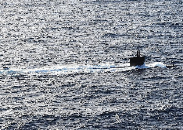 The Los Angeles-class attack submarine USS Helena (SSN 725) transits the Atlantic Ocean with the USS Dwight D. Eisenhower (CVN 69), the flagship of the Eisenhower Carrier Strike Group.